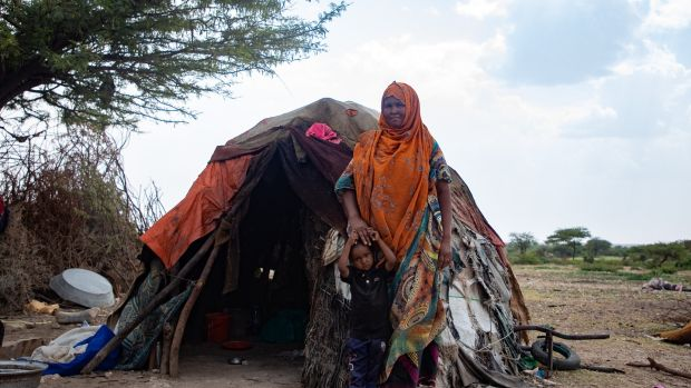 Sahra Mohamud with youngest child Omar. Sahra used to have 250 livestock, but the drought of 2017 killed 140 and the following cyclone killed 110. Now her family only have five sheep and one cow. Photograph: Gavin Douglas/Concern Worldwide