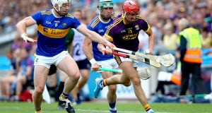 Wexford's Paul Morris is tackled by Tipperary's Padraic Maher during the All-Ireland SHC semi-final in Croke Park. Photograph: Ryan Byrne/Inpho