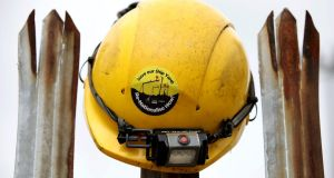 Down tools: a Harland and Wolff worker's  helmet on railings near the shipyard in Belfast on August 5th. Photograph:  Paul Faith/AFPGetty