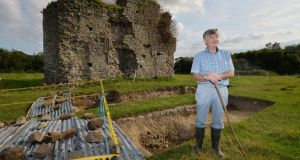 John McCullen at the excavations of a 13th-century monastic site on his farm at Beamore, Co Meath.   The excavations are being funded by FBD. Photograph: Alan Betson/The Irish Times