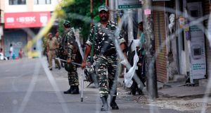 Security personnel patrol along a street in Jammu on Tuesday. Photograph: Rakesh Bakshi/AFP/Getty Images