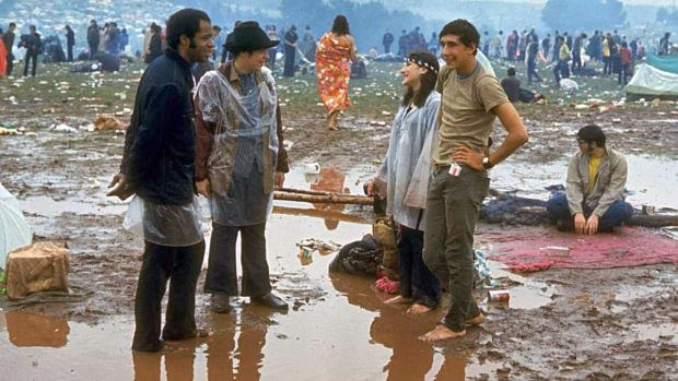"""Young people standing in the mud & water talking, during the Woodstock Music & Art Fair."" Photograph: John Dominis/LIFE Picture Collection/Getty Images"