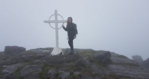 Rachel Flaherty on the top of Galtymore in the heavy rain and strong winds last weekend