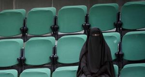 A woman sits in the public gallery of the Dutch senate before a debate on legislation concerning face covering in public places on November 23rd, 2016. Photograph: Bart Maat/EPA