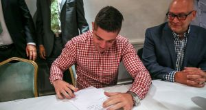 Joe Ward beside  Lou DiBella of DiBella Entertainment as he signs his first professional contract in the Westbury Hotel in Dublin yesterday. Photograph: Gary Carr/Inpho