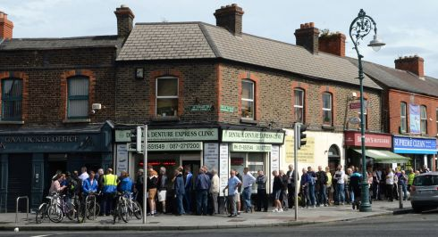 ROLL UP, ROLL UP: Queues for ticket sales for this weekend's semi-final between Dublin and Mayo at the GAA ticket office on Dorset Street, Dublin. Photograph: Dara Mac Donaill