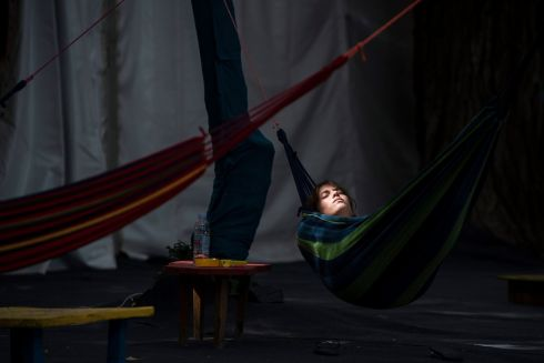 SZIGET SNOOZE: A festivalgoer rests in a hammock on the grounds of the Sziget festival in Budapest, Hungary, on the eve of the opening. Photograph: Martom Monus/EPA