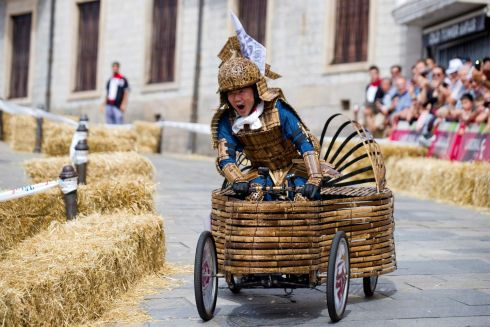 BASQUE DERBY: Japanese driver Yoshihiro Yamagishi participates in the fourth edition of the race of 'goitiberas', homemade vehicles, during the traditional festivities in honour of the Virgen Blanca (White Virgin), the patron saint of the city, in Vitoria, Alava, Basque Country, northern Spain. Photograph: David Aguilar/EPA