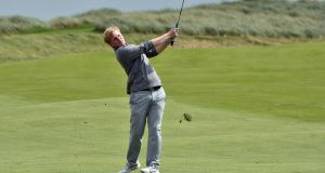 Alan Fahy (Dun Laoghaire) pitching to the sixth green during  his Irish Amateur Close   quarter-final victory over Eoin Murphy  at Ballybunion Golf Club. Photograph:  Pat Cashman