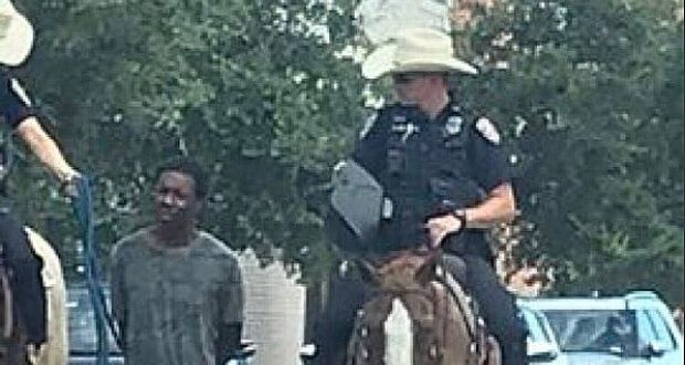 Texas: White police officers on horseback lead black man by rope