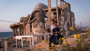 Karma, a 19-year-old cellist, plays facing the ocean in Gaza