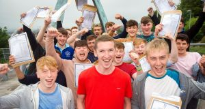 Student Alex Burke, centre,  with his former classmates after receiving their Leaving Cert exam results at Christian Brothers College, Cork, last year. Phtotograph: Daragh Mc Sweeney/Provision