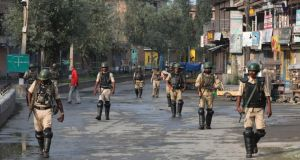 Indian paramilitary soldiers patrol during curfew in Srinagar, the summer capital of Indian Kashmir on Wednesday. Photograph: Farooq Khan/EPA