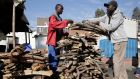 A youth  sells firewood in Mabvuku, Harare, Zimbabwe, as power cuts continue. Photograph: Aaron Ufumeli
