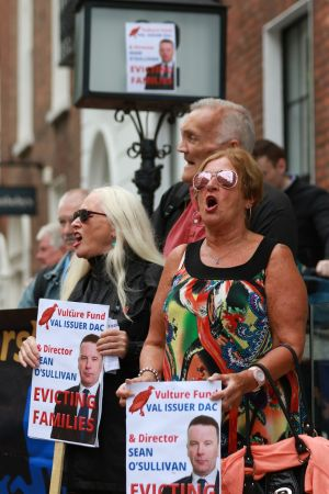 VULTURE FUNDS: June Maher and Rose Walsh during a People Before Profit protest outside the head office of vulture fund, Val Issuer Dac, at 32 Molesworth Street, against the mass eviction of tenants in Portobello. Photograph: Nick Bradshaw