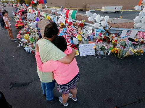 EL PASO: A man and woman hug while standing at the makeshift memorial for the victims of the mass shooting at a Walmart in El Paso, Texas. Twenty-two people were killed in the attack last Saturday. Photograph: Larry W Smith/EPA