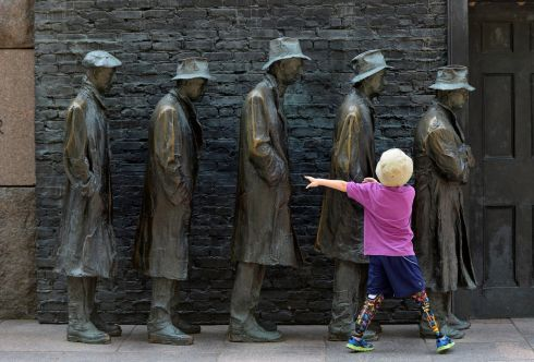 DARKER TIMES: Ulysses Watko (7) visiting from Portland, Oregon, plays amid The Breadline sculpture at the Franklin Delano Roosevelt Memorial in Washington. Photograph: Mary F Calvert/Reuters
