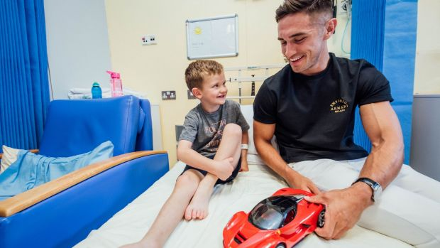 Love Island winner Greg O Shea meets Dion Quigley (6) during a visit to the Children's Ark in University Hospital Limerick on Wednesday. Photograph: Brian Arthur