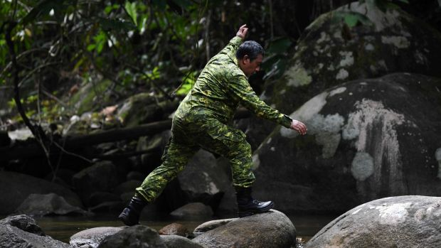 A member of a Malaysian rescue team takes part in the search. Photograph: Mohd Rasfan/AFP/Getty