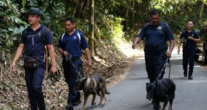 A police unit team searching for Nóra Quoirin. Photograph: Lai Seng Sin/AP