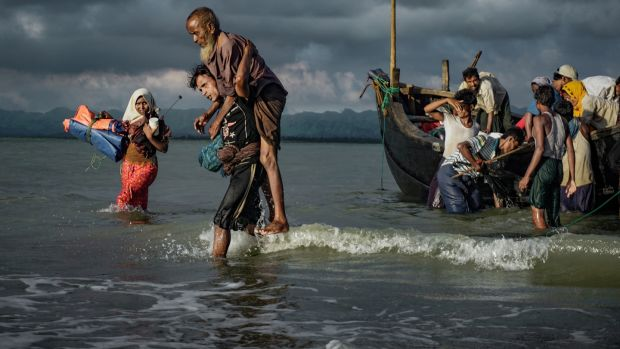 Rohingya Muslim refugees disembark from a boat on the Bangladeshi side of Naf river in Teknaf. Photograph: Masfiqur Sohan/NurPhoto via Getty Images