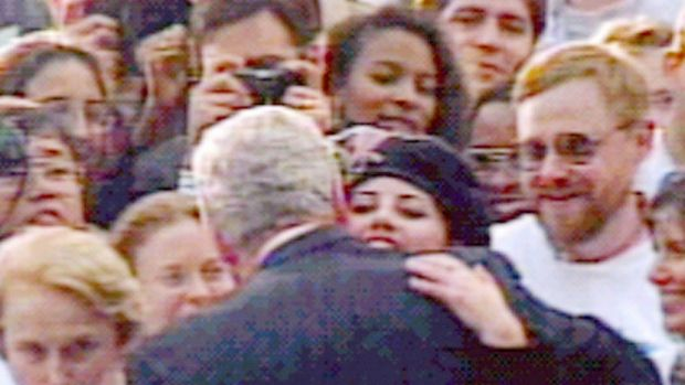 US president Bill Clinton embraces Monica Lewinsky in a crowd outside the White House in a scene which has become one of the most prominent images of the sex scandal. Photograph: Larry Downing/ Reuters