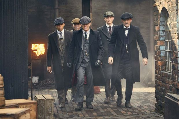 Cillian Murphy as Tommy Shelby with his gang in Peaky Blinders