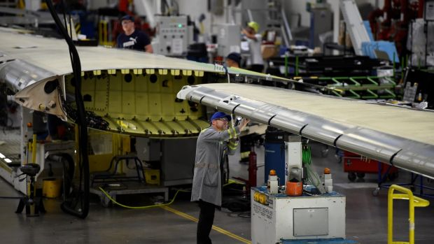 A worker inspecting an aircraft wing in a Bombardier factory in Belfast. The Canadian aerospace giant announced plans to sell its aerostructures business in Belfast earlier this year. Photograph: Reuters/Clodagh Kilcoyne