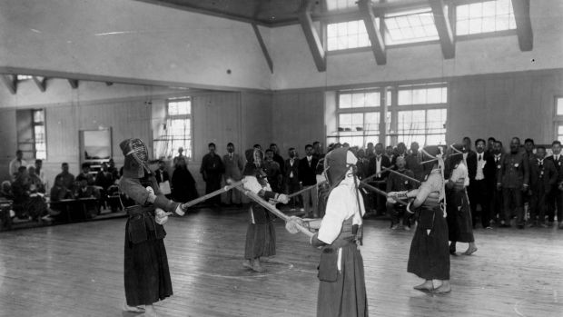 Young people learning Kendo, a Japanese sport similar to fencing, at the Joyama military school in Tokyo circa 1938. Photograph: General Photographic Agency/Getty Images