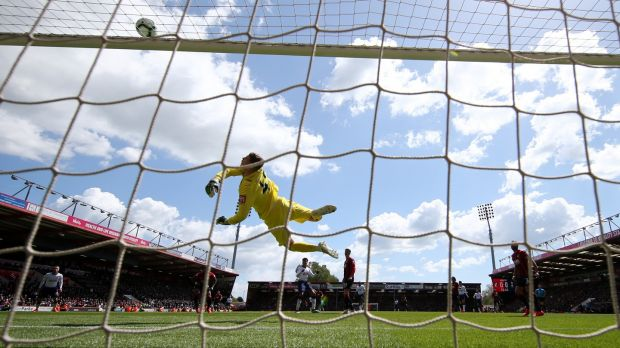 Mark Travers of AFC Bournemouth makes a save during his debut against Tottenham last May. Photo: Warren Little/Getty Images