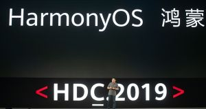 Richard Yu, head of Huawei's consumer business, unveils the company's new HarmonyOS operating system during a press conference in Dongguan, Guangdong province