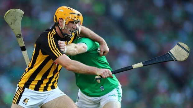 Kilkenny's Colin Fennelly and Richie English of Limerick in the GAA Hurling All-Ireland Senior Championship semi final. Photograph: James Crombie/Inpho