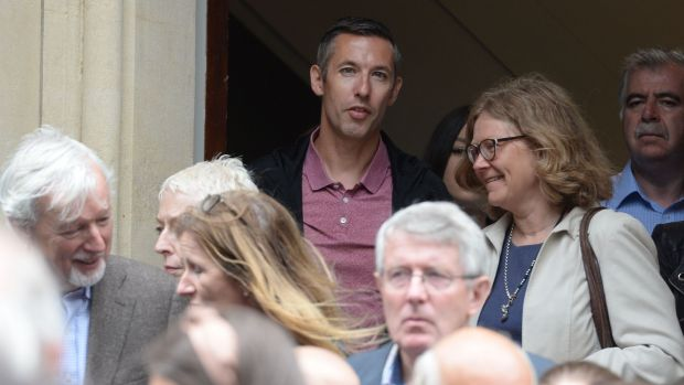 Writer and former colleague Shane Hegarty, with Sylvia Thompson at the funeral of Kate Holmquist. Photograph: Alan Betson / The Irish Times