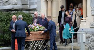 Ferdia Mac Anna,  husband of  the late Irish Times journalist  Kate Holmquist and members of her family accompany her coffin at her funeral service in St Pauls Church, Silchester Road, Glenageary. Photograph: Alan Betson/ The Irish Times