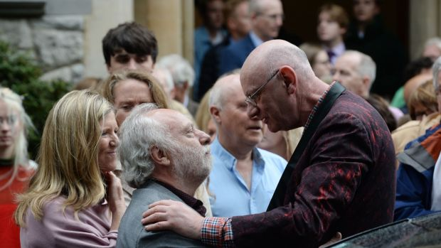 Brian Keenan sympathises with Ferdia Mac Anna, husband to the late Irish Times journalist Kate Holmquist at her funeral service at St Pauls Church, Silchester Road, Glenageary, Dublin, on Friday. Photograph: Alan Betson/The Irish Times