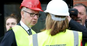 British cabinet secretary Michael Gove speaks with Clare Guinness, chief executive officer of Warrenpoint Harbour on a visit to the Border. Photograph: Paul Faith/AFP