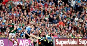 Dublin's Dean Rock kicks the winning point in the 2017 All-Ireland final. Photograph: Ryan Byrne/Inpho
