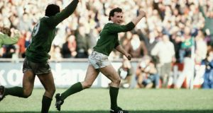 Michael Kiernan celebrates the drop goal that sealed victory over England and a Triple Crown for Ireland in 1985. Photograph: Billy Stickland/Inpho