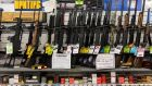 Guns and ammunition on sale at a shop in Sacramento, California.  About a third of US gun owners have five guns or more, figures show. Photograph: Andrew Burton/The New York Times