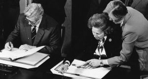 "Taoiseach Garret FtizGerald and  British prime minister Margaret Thatcher signing  the Anglo-Irish agreement. ""We will have to work with the British and they with us to get out of the present unfortunate situation."" Photograph: Matt Kavanagh"
