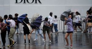 People walk in the rainstorm as typhoon Lekima approaches in Shanghai, China. Photograph: Aly Song/Reuters
