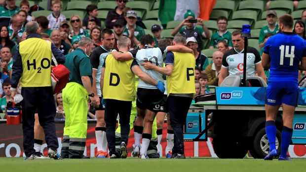 Joey Carbery of Ireland leaves the field injured. Photograph: Donall Farmer/PA Wire.
