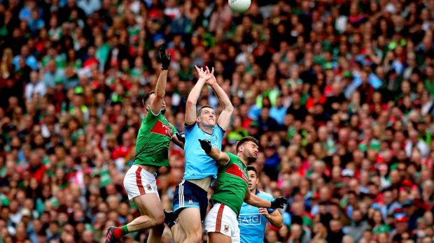 Dublin's Brian Fenton with Aidan O'Shea and Seamus O'Shea of Mayo. Photograph: Ryan Byrne/Inpho