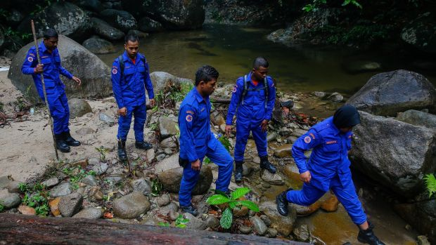 Malaysia Civil Defence Force officers participate in a search and rescue operation for 15-year-old Nóra Quoirin in Seremban, Negeri Sembilan, Malaysia, August 11th 2019. Photograph: Fazry Izmail/EPA