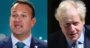 Leo Varadkar and Boris Johnson: A meeting between the two leaders is not expected until after the next G7 summit. Photographs: Francois Lenoir/Reuters and Simon Dawson/Bloomberg