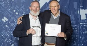 Dublin Airport spatial data manager Morgan Crumlish receiving the award from Jack Dangermond, co-founder and president  of Environmental Systems Research Institute (ESRI)