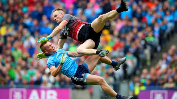Dublin's Con O'Callaghan collides with Rob Hennelly. Photograph: Tommy Dickson/Inpho