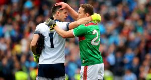 Dublin goalkeeper Stephen Cluxton with Andy Moran of Mayo after the game. Photograph: Ryan Byrne/inpho