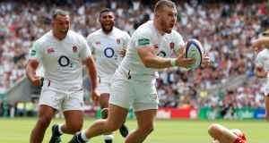Luke Cowan Dickie celebrates scoring England's  third try during the Rugby World Cup warm-up game against Wales  at  Twickenham. Photograph: David Klein/Reuters