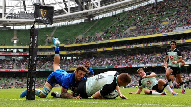 Andrew Conway dives over to score Ireland's third try as he is tackled by Matteo Minozzi of Italy at the Aviva Stadium on Saturday. Photo by Dan Mullan/Getty Images)